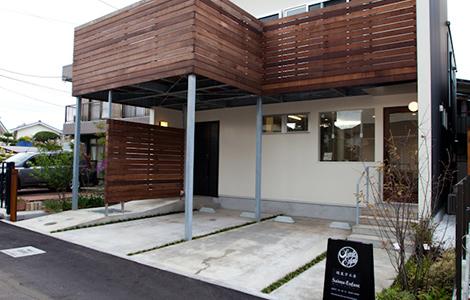開放的な店舗と<br>趣味をいかした居住スペースを<br>兼ねた店舗併用住宅。